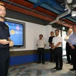 Photo caption: Prof Stefano Schiavon provided an overview of the SinBerBEST technologies to BCA CEO Hugh Lim (in blue), Minister Desmond Lee (on Mr Lim's right), and FEC BE Cluster Sub-committee members.